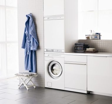 White laundry design with Asko appliances